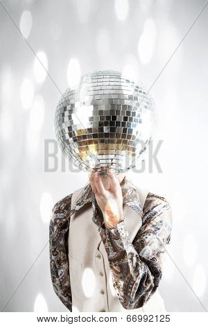 Instagram filtered image of a man holding a disco ball