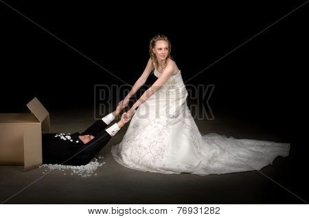 Bride getting a brand new husband out of a box