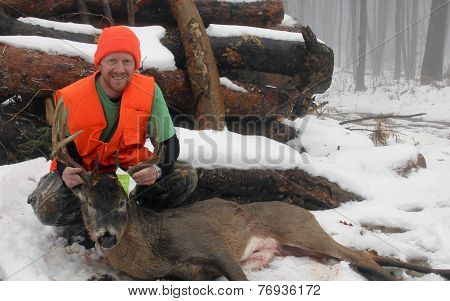 Hunter With A Trophy Whitetail Ten Point Buck