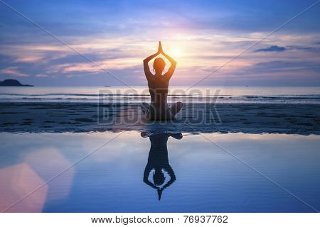Yoga on the sea beach, meditation.