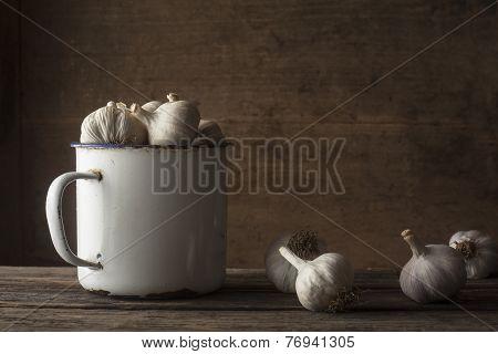 garlic with vintage iron mug