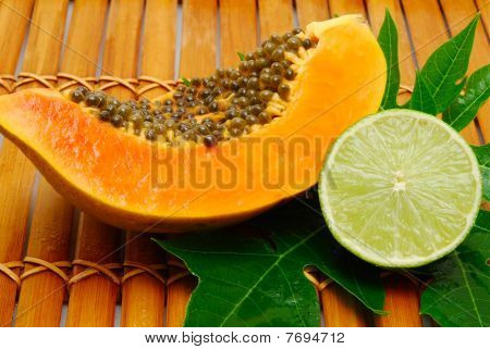 Papaya And Lime On Bamboo