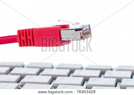 network cable to keyboard, symbol photo for flat rate, e-commerce, global communication