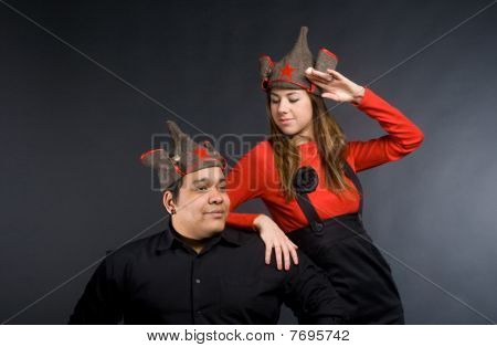 Young Couple In Russian Military Hats