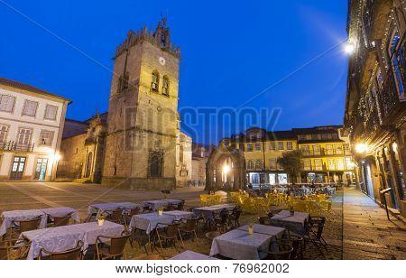 Oliveira square with church and Padrao do Salado monument, Guimaraes, Portugal