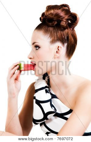 Young Woman Eating Fruit - Isolated