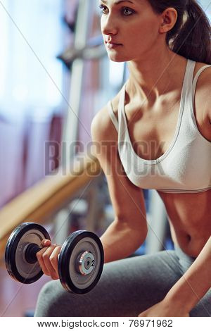 Young woman pumping iron poster