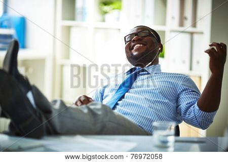Office worker listening to music at workplace