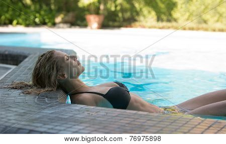 Beautiful sexy woman rest in swimming pool