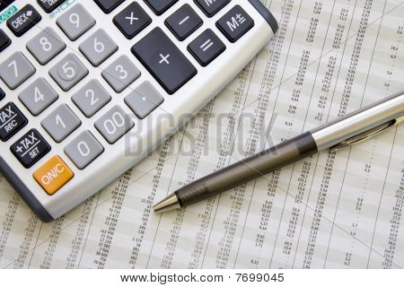 Balancing The Accounts. Calculator, Pen