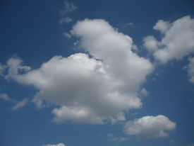 pair of light blue sky, white clouds