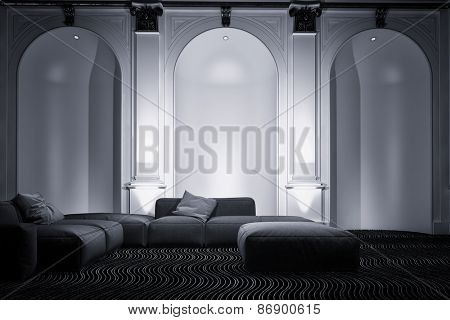 Elegant living room interior with tall arched wall alcoves accented by down lights and a comfortable modular lounge suite, greyscale image. 3d Rendering