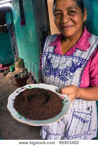coffee farmer's wife with ground coffee
