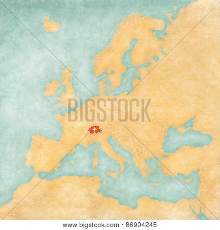 Switzerland (Swiss flag) on the map of Europe. The Map is in vintage summer style and sunny mood. The map has soft grunge and vintage atmosphere which acts as watercolor painting on old paper.