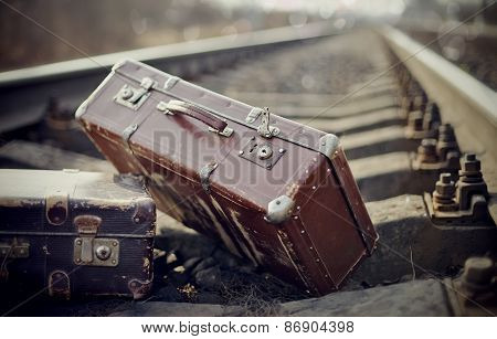 Two Vintage Suitcases On Rails