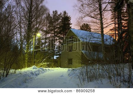 Country Brick House And  Street Lamp In  Evening
