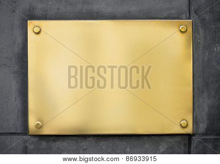 blank gold metal signboard or nameboard on wall