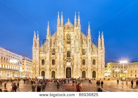 Milan Cathedral, Duomo di Milano, is the gothic cathedral church of Milan, Italy. Shot in the dusk from the square ful of people. poster