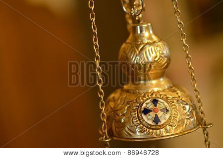 Isolated gold orthodox censer in natural light poster