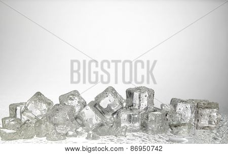 cold ice cubes on the white background