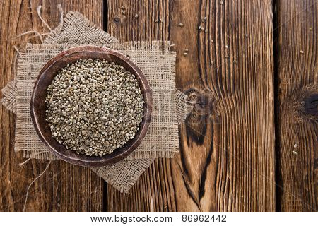 Heap of Hemp Seeds on wooden background (cloese-up shot) poster