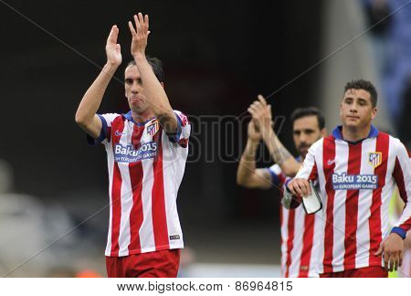 BARCELONA - MARCH, 14: Diego Godin of Atletico Madrid clapping supporters after of Spanish League match against RCD Espanyol at the Estadi Cornella on March 14, 2015 in Barcelona, Spain