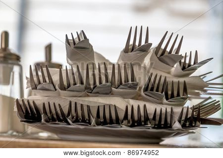 cutlery with forks and knives, symbol for catering, service, hospitality