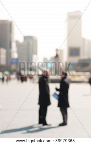 Two Businessman Chatting Converstion On Street