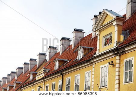 Chimneys And Red-tiled Roofs Of  Building In Old Riga