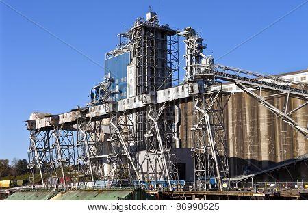 Grain elevators barge and tower Portland Oregon. poster