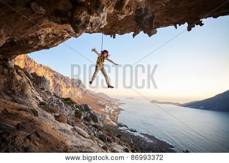 Seven-year old girl climber hanging on rope