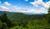 The Newfound Gap overlook straddles the North Carolina and Tennessee state line and is one of the most popular tourist stops in the Great Smoky Mountains National Park. poster