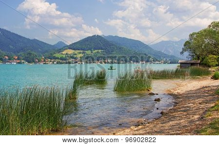 tranquil scenery at lake shore tegernsee with fisherman and mountain view poster