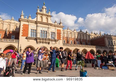 KRAKOW, POLAND - JUL 11, 2015: Participants at the annually (July 9-12) 28th International Festival of Street Theatres - Orchestre International du Vetex (Belgium/France) in the Main Square of Krakow.