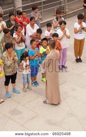A Buddhist Monk Leading Prayer
