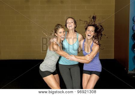 Three Happy Athletic Females