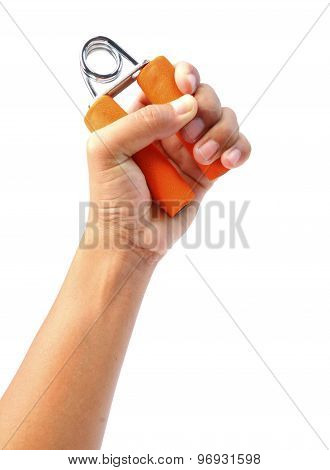 Female hand holding orange hand trainers isolated on white background clipping path.