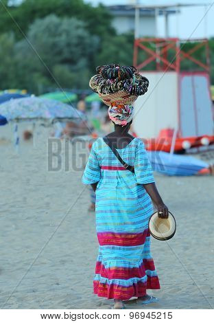 African Woman Peddler Of Necklaces And Bracelets On The Beach