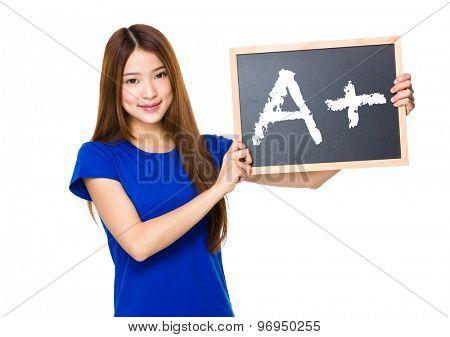 Beautiful asian women asian hold wood blackboard showing A plus mark
