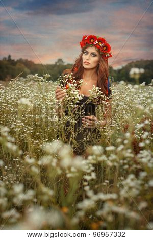 Beautiful Girl With A Wreath On Her Head.