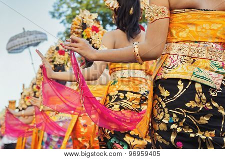 Balinese Women In Bright Costumes With Traditional Decorations