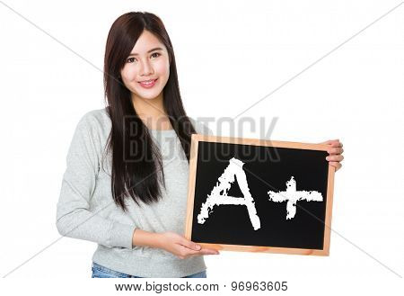 Young woman hold with chalkboard showing mark A plus