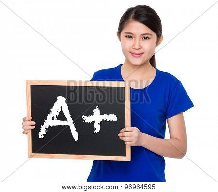 Asian student show with blackboard A plus mark