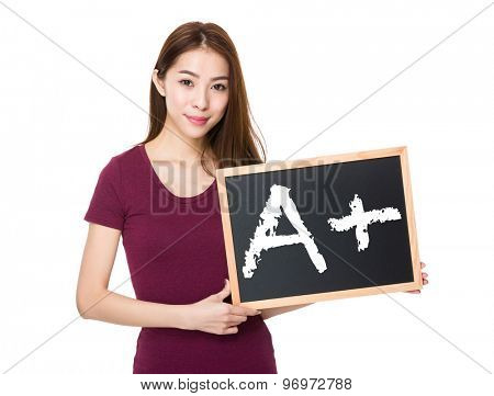 Young woman with blackboard showing mark A plus