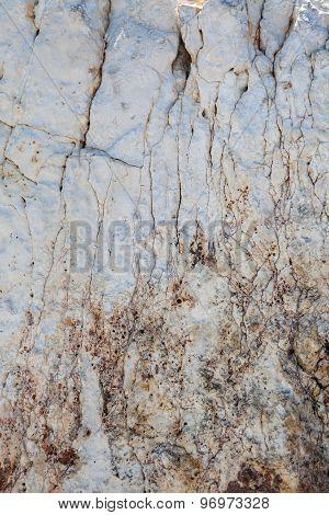 Furrowed cracked white stone background