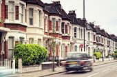 """Terraced Houses and blured """"Black Cab""""in Clapham London. (Long exposure) poster"""