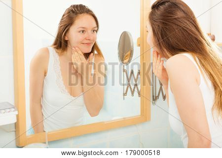 Woman Without Makeup In Bathroom.