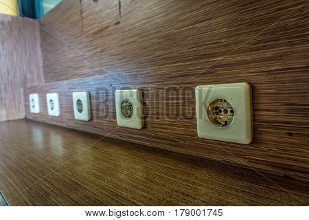 electric socket on wooden wall at charging facility in public area photo taken in Jakarta Indonesia java