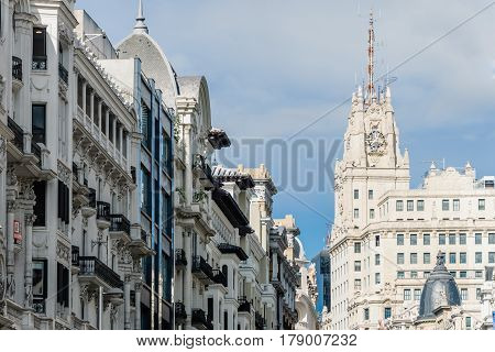 Madrid Spain - September 18 2016: Low angle view of buildings at Gran Via Street in Madrid. Telefonica Building on background. It is an important street in Central Madrid with shops and theaters.