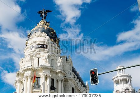 Madrid Spain - September 18 2016: Low angle view of buildings at Gran Via Street in Madrid. Metropolis building against cloudy sky. It is an important street in Central Madrid with shops and theaters.